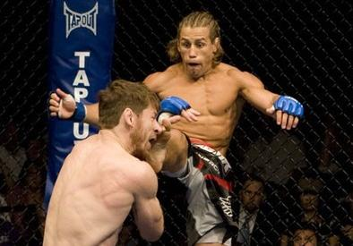 Urijah Faber vs Brown, in photo by Josh Hedges.