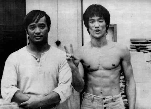 5609308aa72ac Bruce Lee (shirtless) next to friend and Jiu-Jitsu black belt Dan Inosanto.  Photo  GRACIEMAG archives.