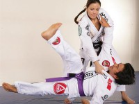 In Singapore, Kyra trains Thai boxing for MMA and holds seminar