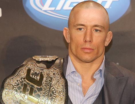 GSP coloca o cinturão em jogo contra Johny Hendricks. Foto: Josh Hedges/Zuffa LLC via Getty Images