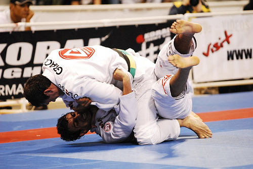 Roger Gracie catches Romulo Barral with a choke from the mount at the 2009 Worlds. Photo by Regis Chen