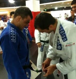 Brodinho receives stripe on belt from professor Gordinho