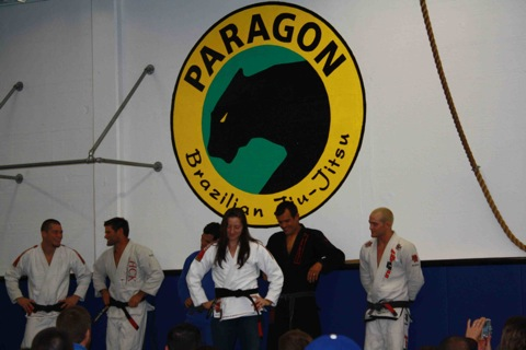 Bill Cooper speaks to new black belts, Sean Apperson, while Katrina shows her new belt to Franjinha, Jeff Glover and the whole team at the Santa Barbara academy. Photo: Publicity.
