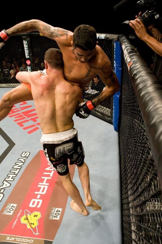 Ricardo Almeida gets a takedown on Kendall Grove. Photo: Josh Hedges