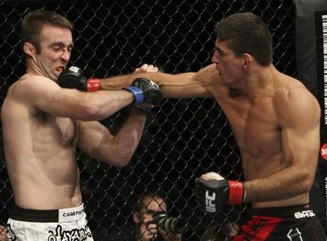 Paulo Thiago in his last UFC win, in a photo by Josh Hedges