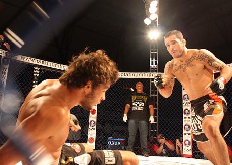 Diego Braga gets knockdown on Milton Vieira. Photo: Carlos Ozorio
