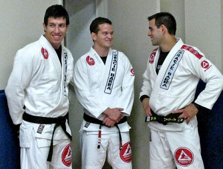 Marco Joca (center) teaches a triangle choke