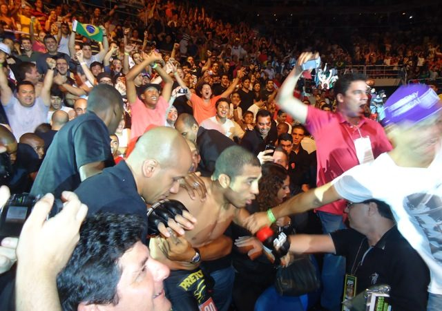 José Aldo prevails but can't avoid rear-naked choke (from security at UFC 142)