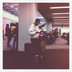 A lone Giants fan at the dismal airport following the 49ers' defeat
