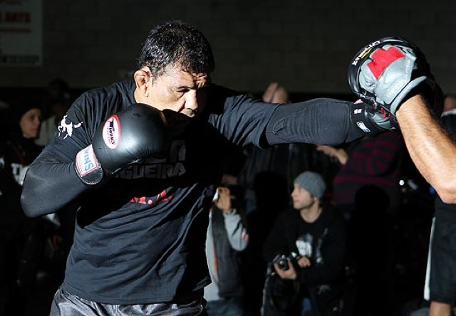 Rodrigo Minotauro hitting the mitts Thai style