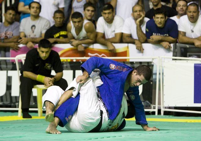 Want to finish a heavier opponent? Sweep from half-guard and sink the arm-triangle