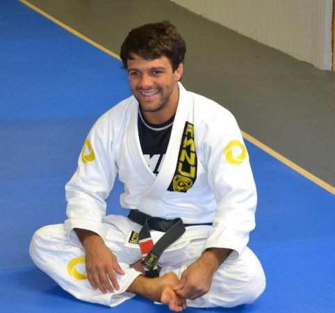 Half-guard sweep to armbar finish, by Robson Moura