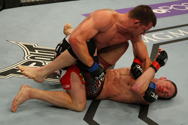 Getting pounded on from above in MMA? Use the guard and armbar