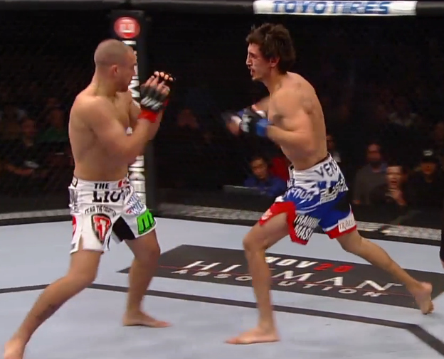 Pablo Garza leans towards Mark Hominick in his road to the victory at UFC 154