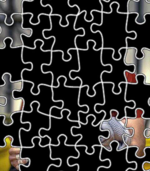 Quem será o misterioso atleta do quebra-cabeças? Foto: Divulgação