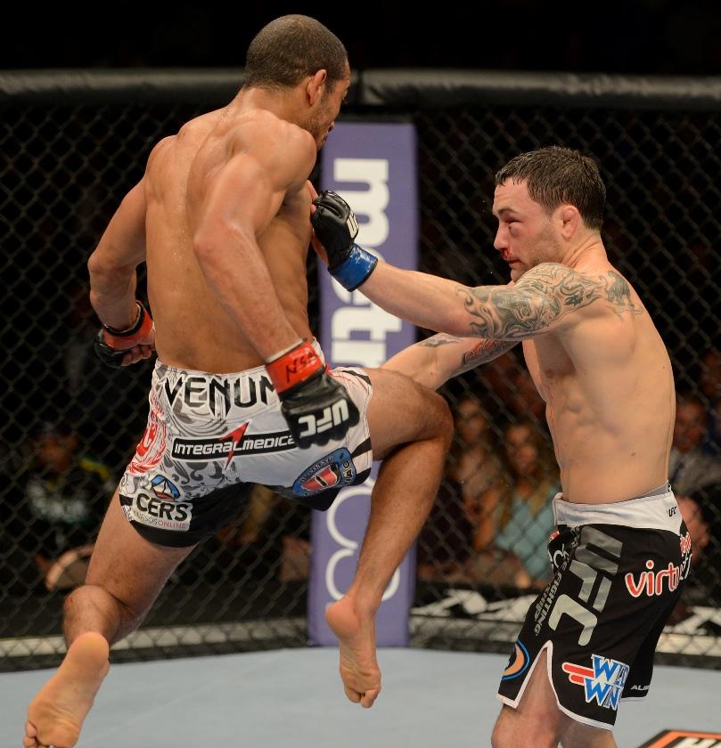 José Aldo voa em joelhada sobre Frankie Edgar. Foto: UFC/Divulgação