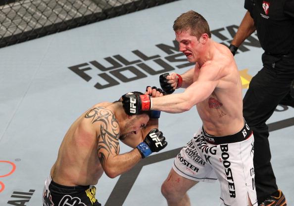 Riddle (dir.) é pego no exame antidoping e está fora do UFC. Foto: Josh Hedges/Zuffa LCC via Getty Images