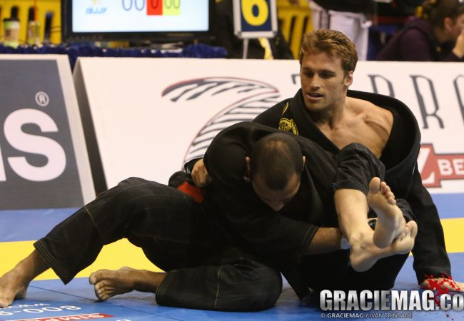 Go from lasso guard to the omoplata with Clark Gracie