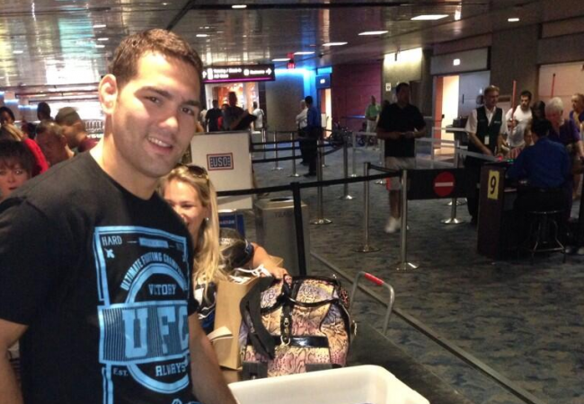Photo: Chris Weidman brings home his shiny new belt