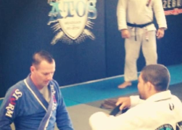 Andre Galvao surprises long-time student with black belt promotion