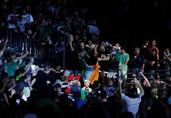 UFC 189: McGregor TKOs Mendes on Rd2 for the interim belt; Lawler retains title after war against MacDonald