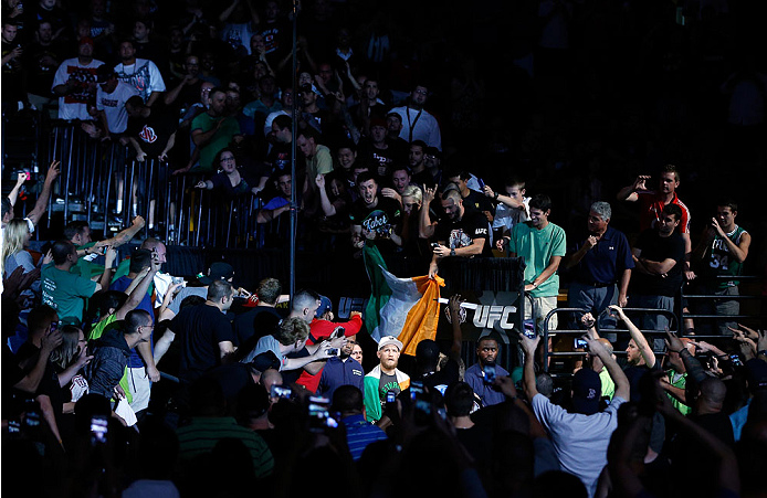 Conor McGregor gets massive greeting from fans during his UFC Fight Night 26 walkout. Photo via Getty Images.