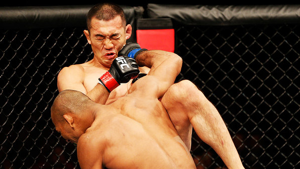 Jacaré punches judoka Yushin Okami at UFC Belo Horizonte. Photo: Josh Hedges / Zuffa via Getty Images