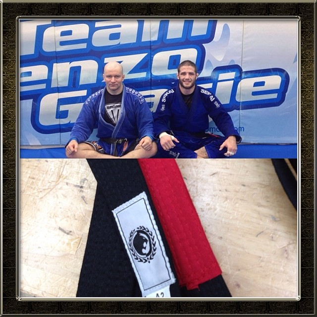 Travis Stevens receives his black belt from John Danaher. Instagram: @judosilencer