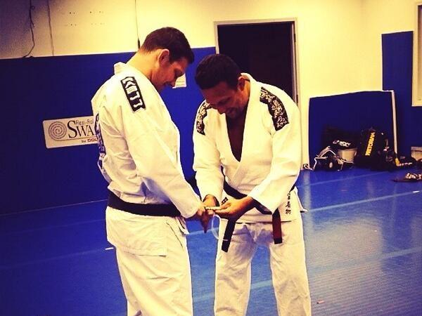 Ricardo Almeida receives 4th degree on his black belt from Renzo Gracie