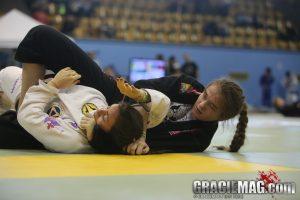 Dominyka secures the choke. Photo: Erin Herle