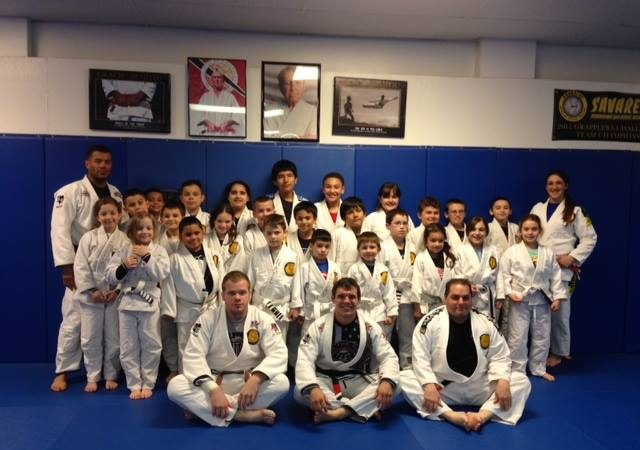 Justin Rader teaches kids at GMA Savarese BJJ takedowns and posture in special seminar