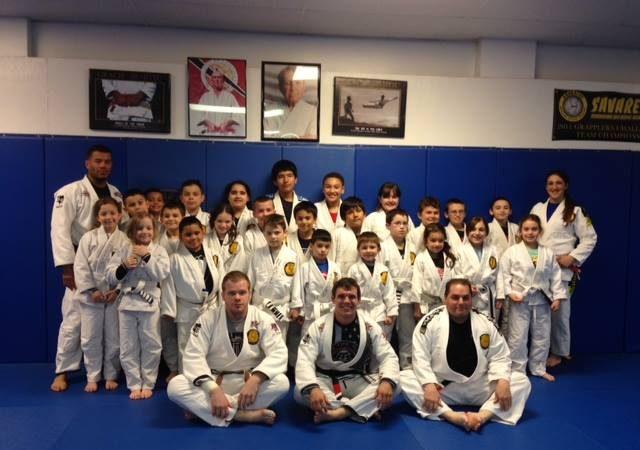 Justin Rader teaches kids at GMA Savarese BJJ takedowns and posture in special seminar