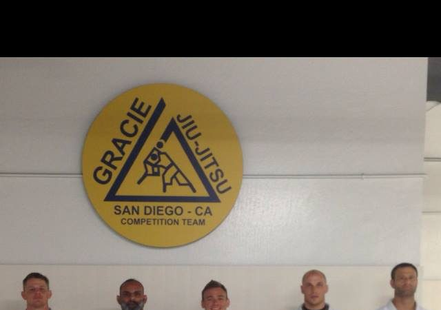Professor JW Wright receives second degree on black belt from Royler Gracie & David Adiv