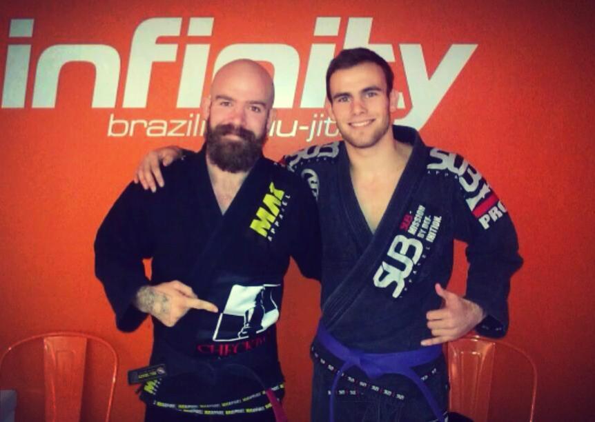 Kit promotes student Joshua Flint to purple belt. Photo: Personal archive