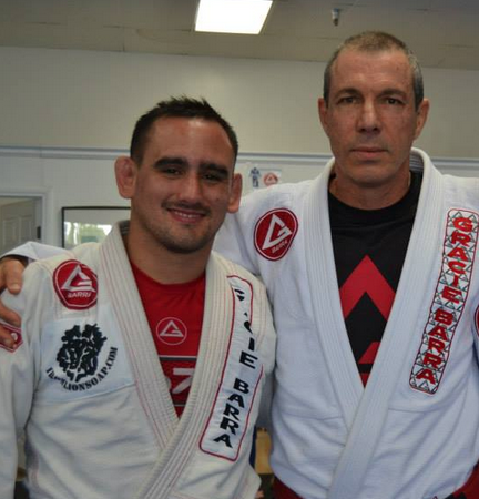 Juan Pablo Garcia receives first degree on black belt from Carlos Gracie Jr