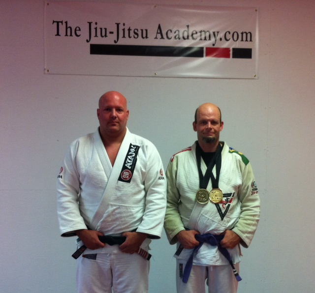 Black Belt Bruce Shepherd proud of his purple-belt student.