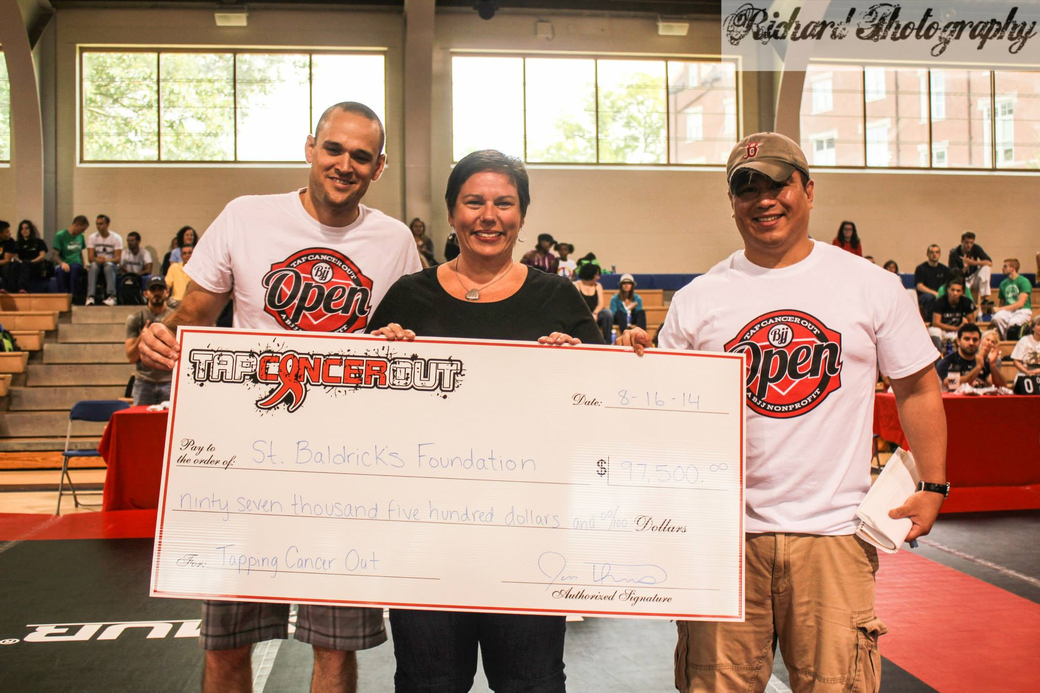 Tap Cancer Out leader Jon Thomas presenting the grand donation. Photo: Gabriel Richard