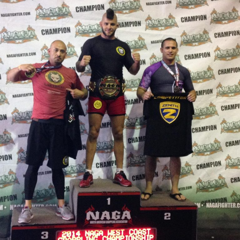 Gabriel Checco receiving the NAGA belt on the podium.