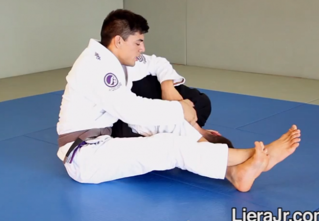 Video: Michael Liera Jr. teaches the omoplata from closed guard used at 2014 Worlds