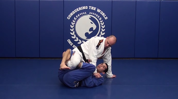 Video: Submit or sweep & pass with Sean Roberts' calf slicer from deep half guard