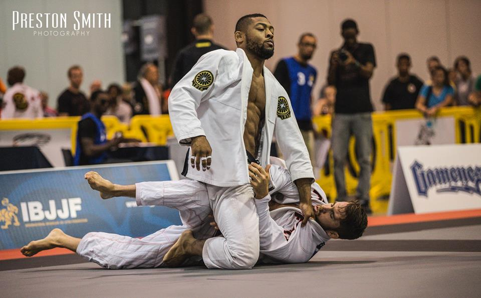 Tim Spriggs mounts his opponent in black belt debut. Photo: Preston Smith