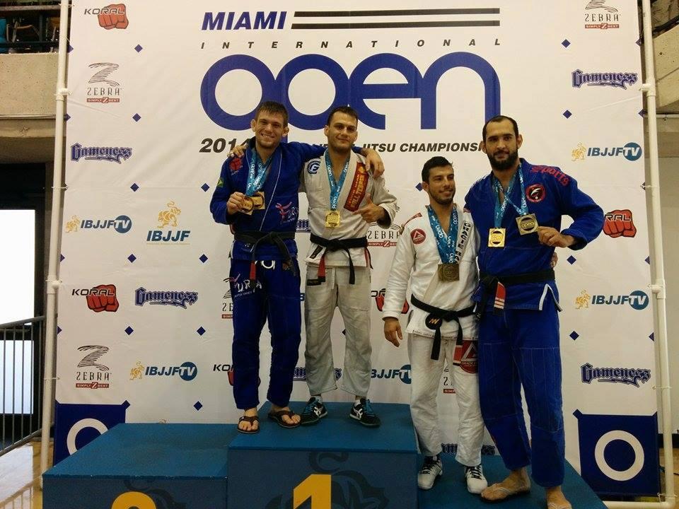 The adult male black belt open class podium