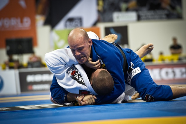 Xande Ribeiro pressures Rodolfo Vieira in 2012 World Championship heavyweight final. (Photo by Dan Rod)