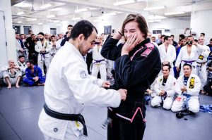 "Dominyka receiving her black belt. Photo: John ""Ric"" Ricard"
