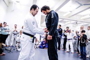 "Marcos receiving his black belt. Photo: John ""Ric"" Ricard"