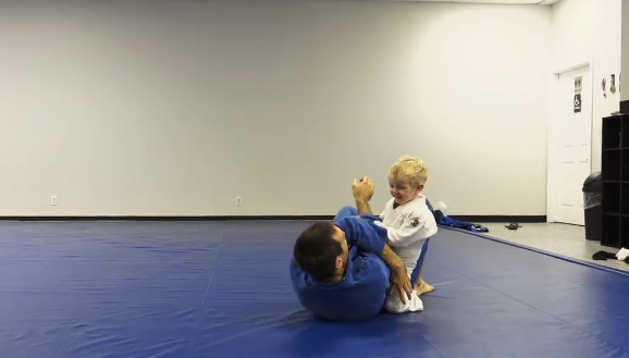 Two-year-old son takes down, passes, armbars, takes the back of black belt dad