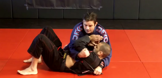 Finish an armbar from side control using opponent's lapel with Ricardo Cavalcanti