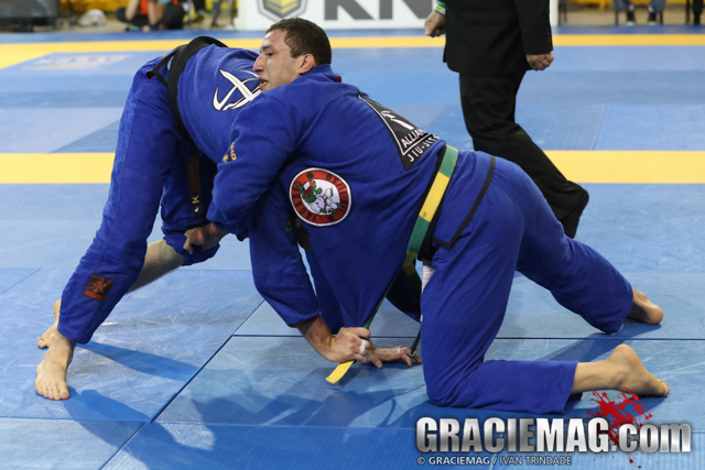 Leo Nogueira beat Keenan Corneliu's dangerous guard game to secure a place in the open class podium at the 2015 Pan. Photo by Ivan trindade/GRACIEMAG