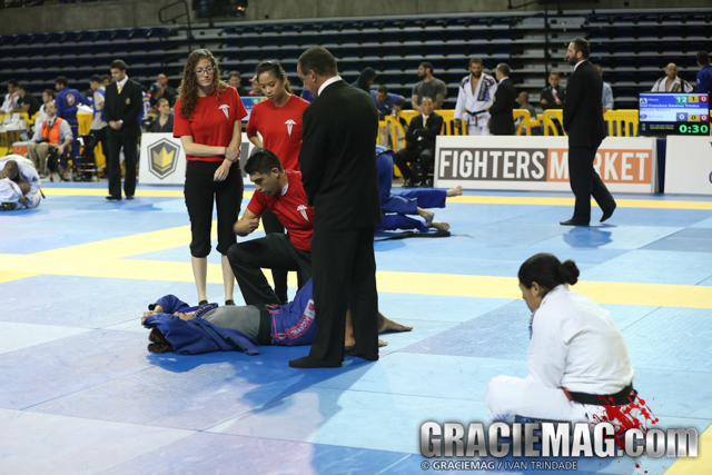 Monique gets medical attention after the ankle lock. Photo by Ivan Trindade/GRACIEMAG