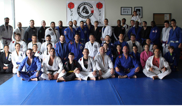 Carlson Gracie Jr. awards GMA Cesar Pereira his 4th degree on the black belt